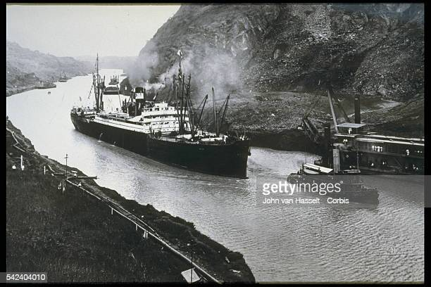 Opening day SS Ancon steamship crossing the Culebra Cut formerly called Gaillard Cut an artificial valley that cuts through the continental divide in...