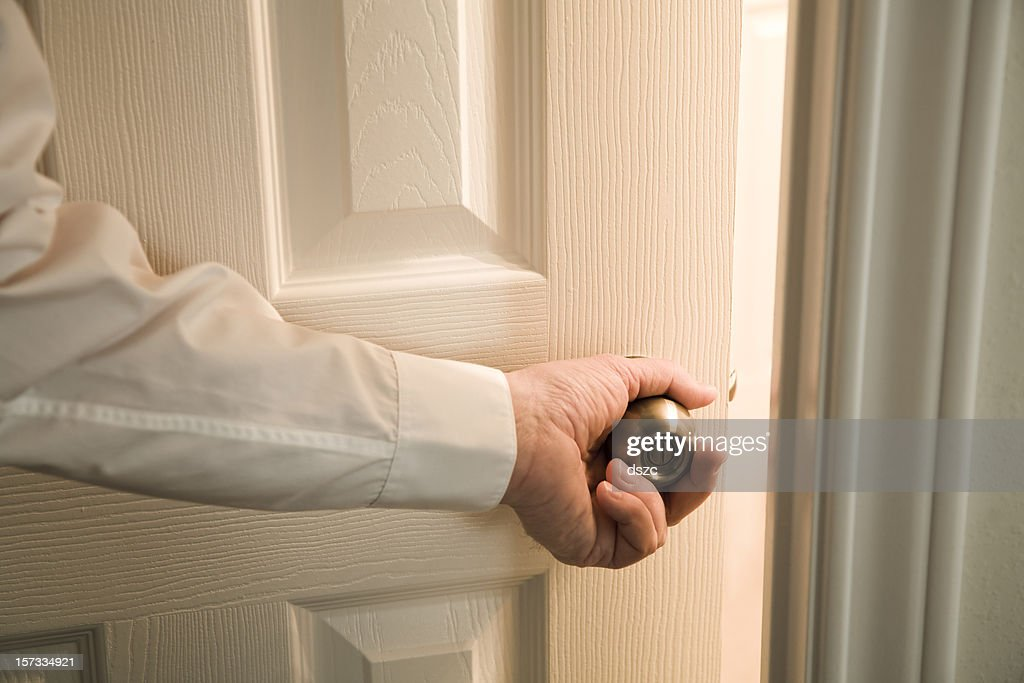 opening door into light unknown room : Stock Photo