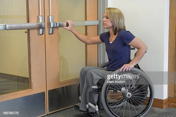 opening doors - woman in wheelchair - paraplegic stock photos and pictures