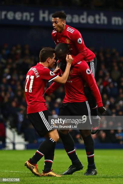 Opening goalscorer Romelu Lukaku of Manchester United celebrates with teammates Jesse Lingard and Ander Herrera during the Premier League match...