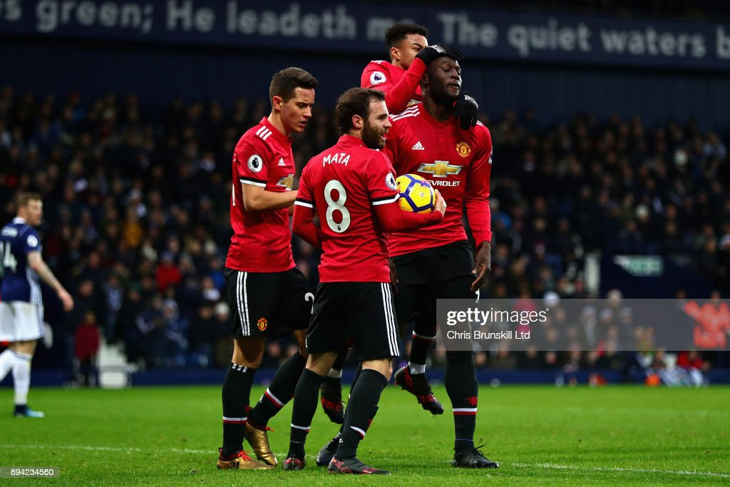 Opening goalscorer Romelu Lukaku of Manchester United celebrates with teammates Juan Mata, Jesse Lingard and Ander Herrera during the Premier League match between West Bromwich Albion and Manchester United at The Hawthorns on December 17, 2017 in West Bromwich, England.