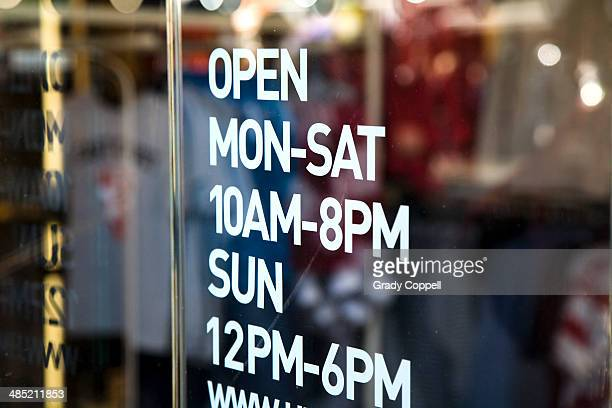 opening hours information - window display stock photos and pictures