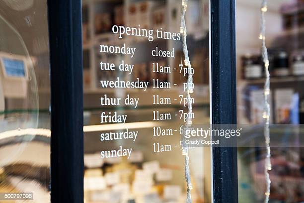 Opening hours sign in shop window