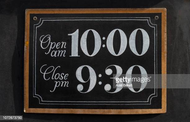 opening hours sign - opening event stock pictures, royalty-free photos & images
