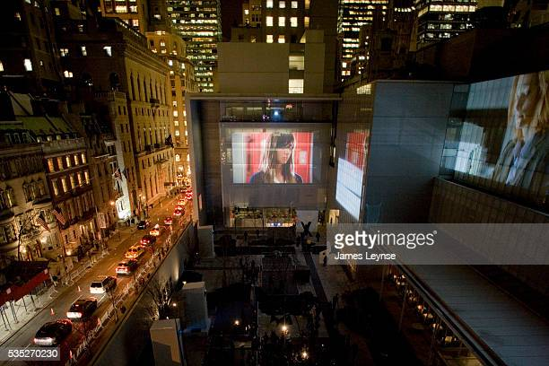 Opening night launch of Doug Aitkens Sleepwalkers a video installation projected onto the facades of the Museum of Modern Art The exhibit free to the...