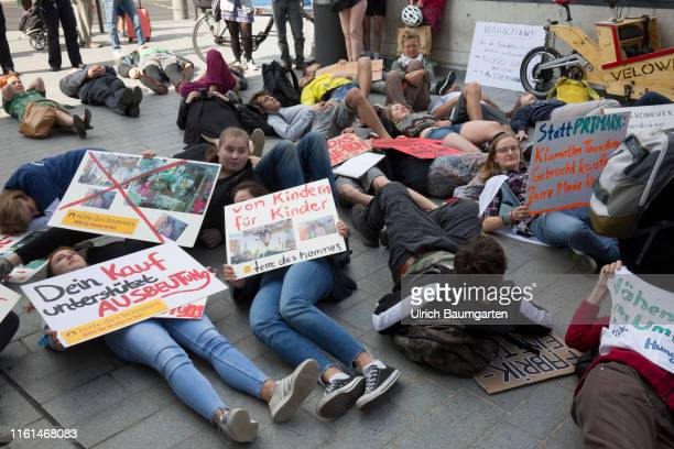 Opening of a Primark branch in Bonn Protest in front of the Primark branch in Bonn city center against child and woman labor against low wages and...