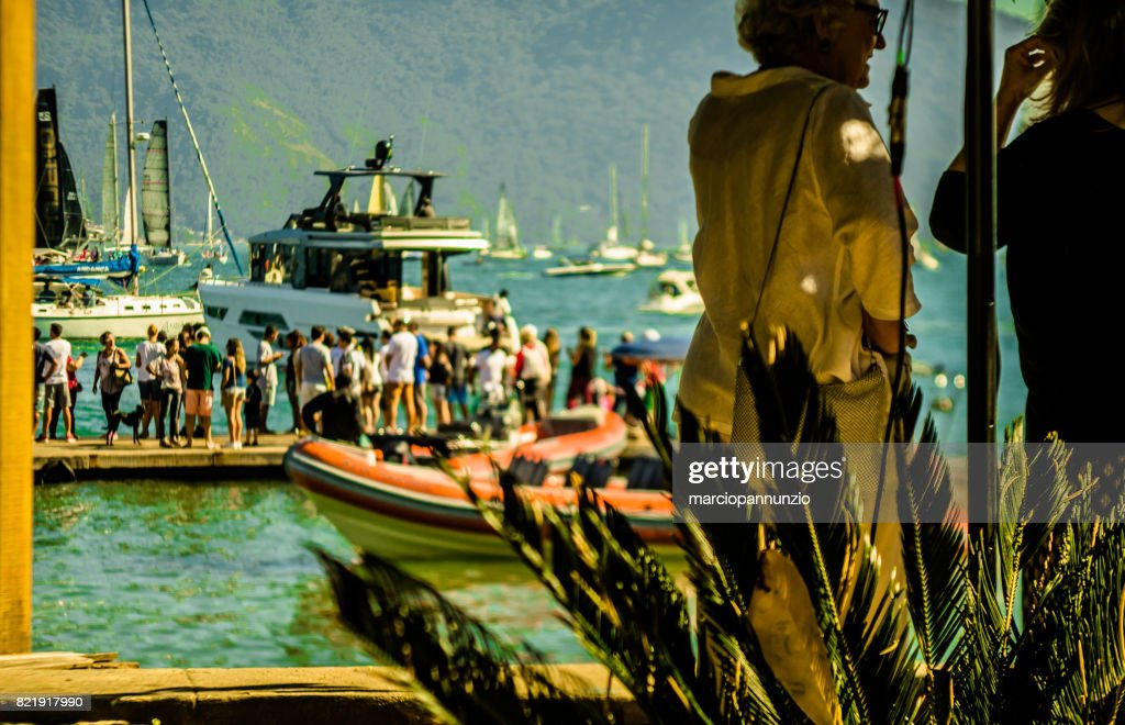 Opening of Ilhabela Sailing week when the parade of sailboats happens in front of the píer da vila in Ilhabela, Brazil : Stock Photo