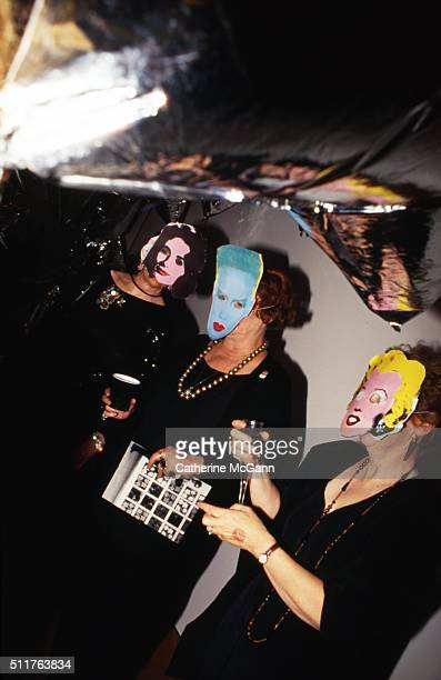 Opening of the Andy Warhol Museum in May 1994 in Pittsburgh PA Pictured LR party goers wear masks of Warhol's paintings of Grace Jones Elizabeth...
