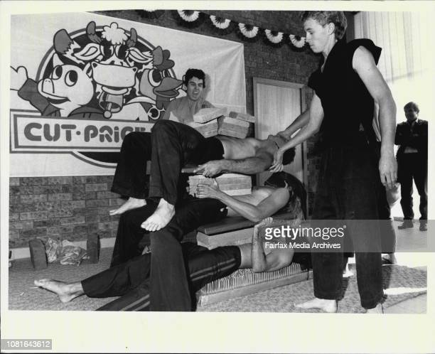 Opening of the CutPriceDeli's new national headquarters at Kingsgrove'Bed of Nails'Gary Johnson lies on a bed of nails with other men on top as a...