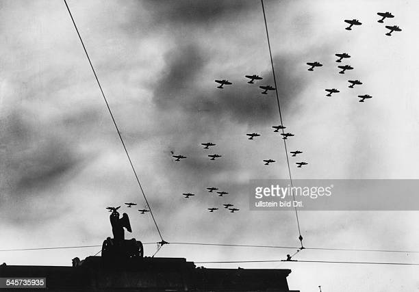 Opening of the parade of the Wehrmacht on Hitler's 50th birthday: a squadron of the Luftwaffe is flying over the Brandenburg Gate, Berlin