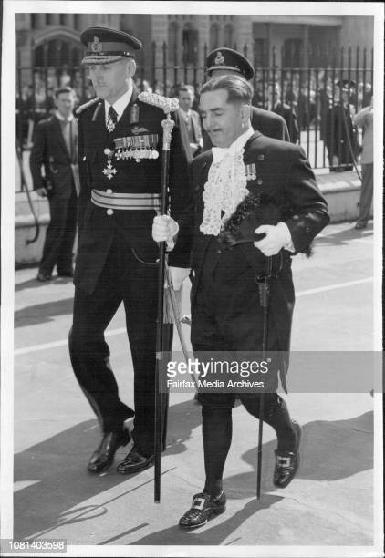 Opening Parliament Governor LtGeneral EW Woodward entering the Legislative Council Chamber accompanied by the Usher of the Black Rod Mr EC Shaw...