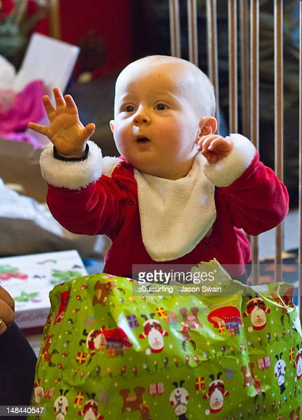 opening presents - s0ulsurfing stock pictures, royalty-free photos & images