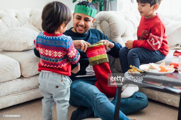 opening stockings - men wearing stockings stock pictures, royalty-free photos & images