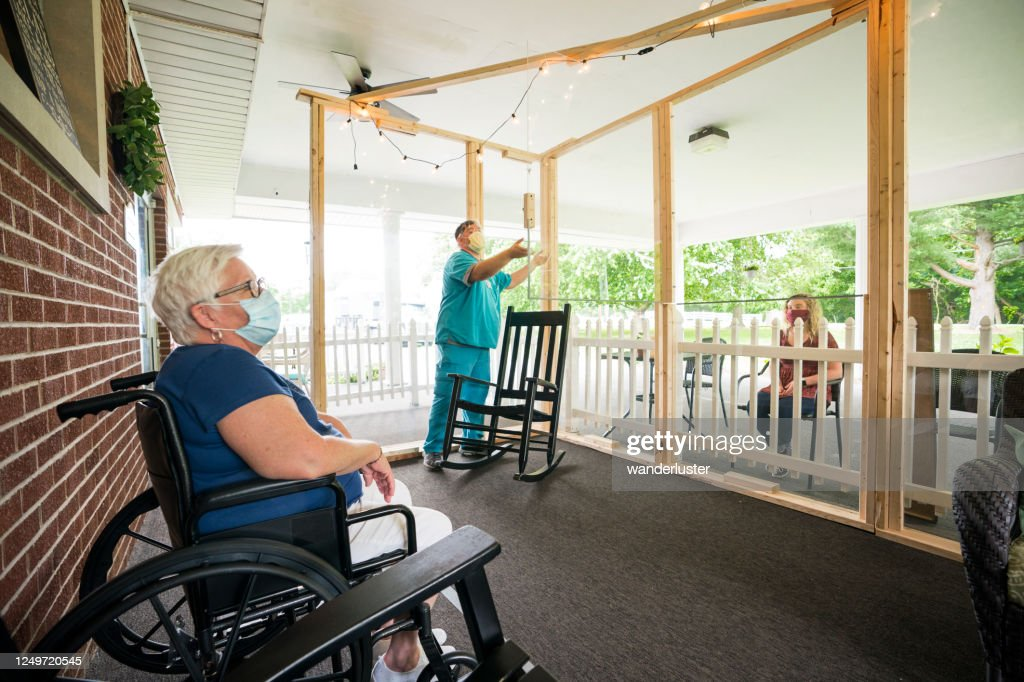 Opening the glass panel on a Covid-19 communication porch : Stock Photo