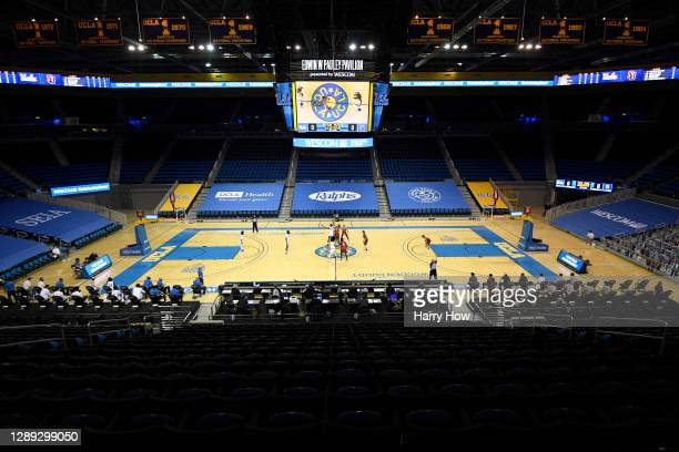 Opening tip off with no spectators to start the game between the Seattle Redhawks and the UCLA Bruins at UCLA Pauley Pavilion on December 03, 2020 in...