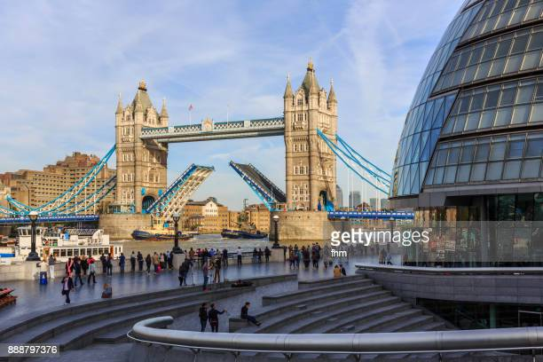 opening tower bridge in london, uk - tower of london stock pictures, royalty-free photos & images