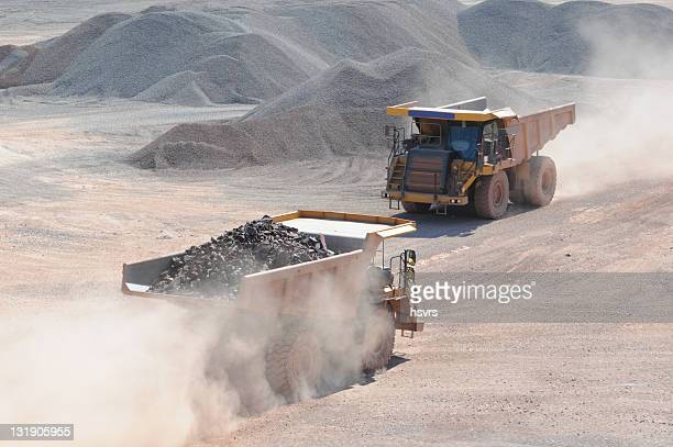 Open-pit Mine with two Dump Trucks