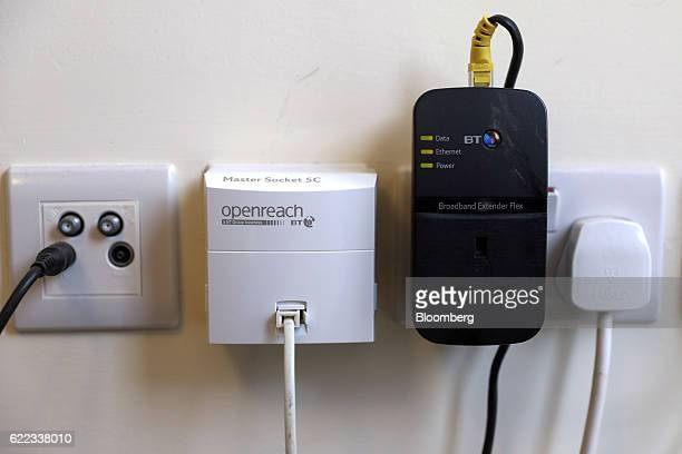 A Openreach phone line second left sits next to a Broadband Extender Terminal second right both provided by BT Group Plc at a residential property in...