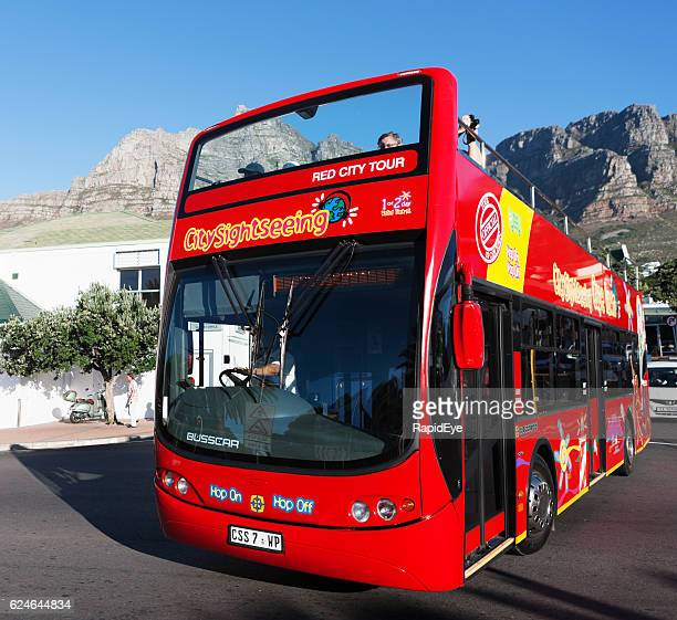 Open-topped, sightseeing tourist bus in Camps Bay, Cape Town