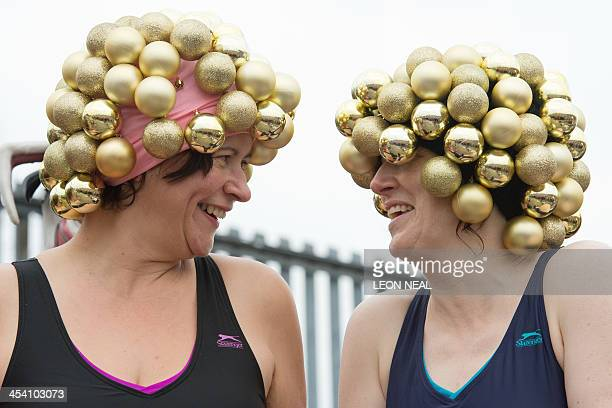 Openwater swimmers prepare to enter the six degree centrigade water as they take part in the annual December Dip at Parliament Hill lido in north...