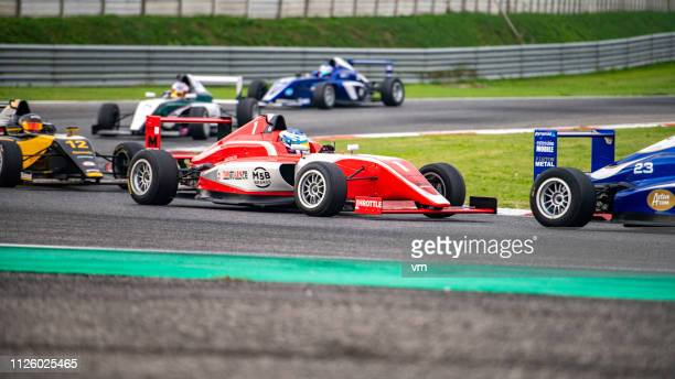 open-wheel car race - grand prix motor racing stock pictures, royalty-free photos & images