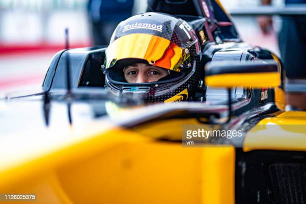 open-wheel race car driver - racing driver stock pictures, royalty-free photos & images