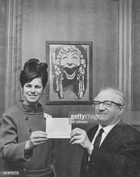 FEB 9 1968 FEB 11 1968 Opera Audition Winner Julius Burger assistant conductor of the Metropolitan Opera presents firstplace award to Mrs Clare...