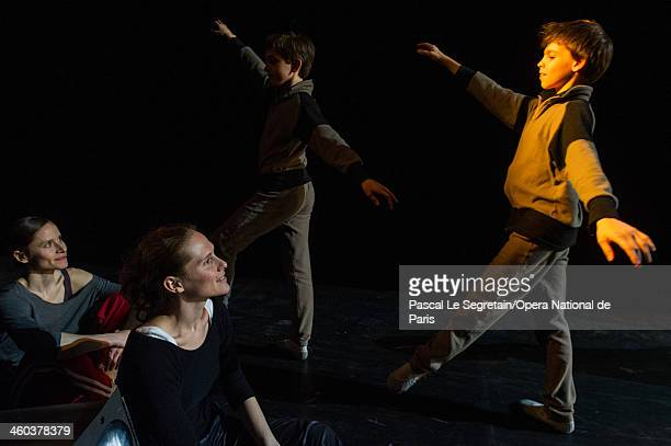Opera Ballet school Pupils walk past Opera Ballet dancers during a rehersal for the Generale Perfomance at Opera Garnier on April 12 2013 in Paris...