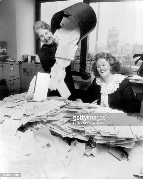 Opera Guild volunteer Sally Greenberg pours out more of the letters under the watchful eye of Dame Joan Sutherland.The live screening on the ABC of...