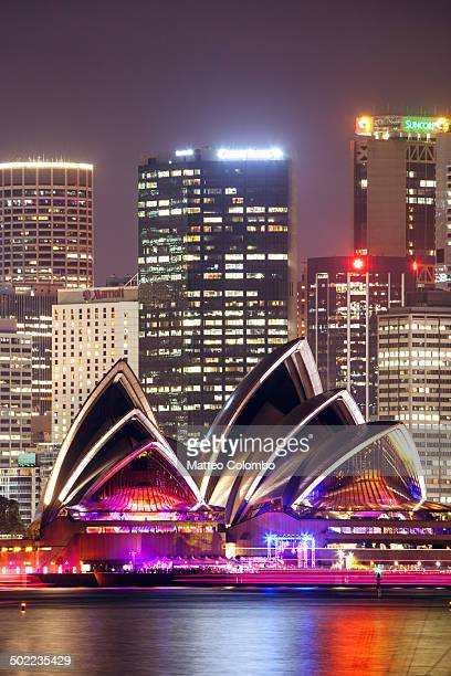 Opera House and skyline with buildings of the central business center CBD at night, illuminated with colorful lights. Sydney, New South Wales,...