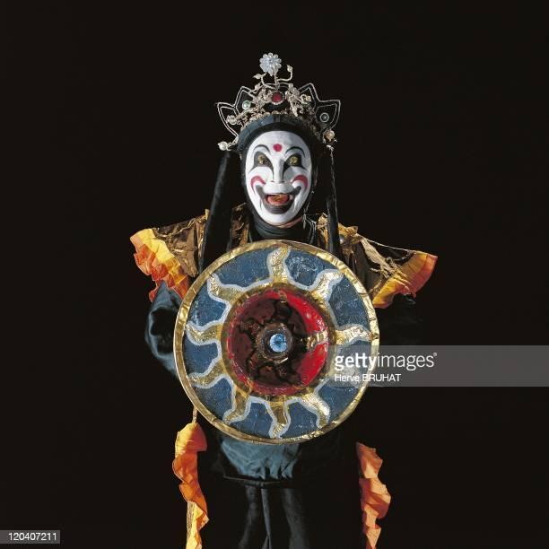 Opera Local Chuanju Mao Ting Qi in Chengdu China in 1998 Mao Ting Qi gets ready to execute Bian Lian the art of changing masks