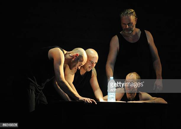 Opera performers Sebastian Roehrle Dino Scandariato Sebastian Kowski and Fuerstenau look perform during rehearsals for the Opera 'Judith' by...