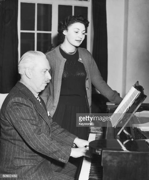 Opera singer Adele Leigh rehearsing her part in 'The Olympians' with British composer Arthur Bliss at Covent garden 16th December 1949