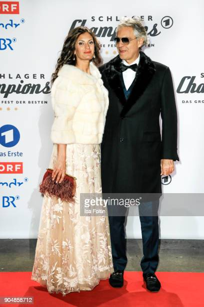 Opera singer Andrea Bocelli and his partner Veronica Berti attend the 'Schlagerchampions Das grosse Fest der Besten' TV Show at Velodrom on January...