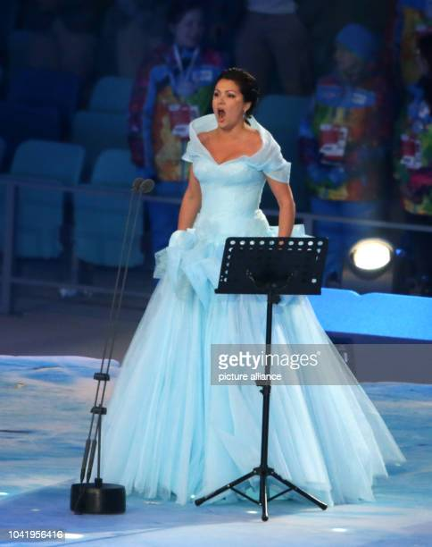 Opera singer Anna Netrebko of Russia sings the Olympic anthem during the Opening Ceremony in Fisht Olympic Stadium at the Sochi 2014 Olympic Games...