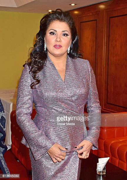 Opera singer Anna Netrebko poses during a photo call at Regent Hotel on October 9 2016 in Berlin Germany The photo call was held to announce a joint...