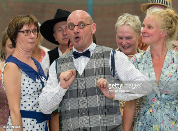 Opera singer Bernd Gebhardt as Baculu rehearses the musical play 'Der Wildschuetz oder die Stimme der Natur' in a school gym in Freienwalde Germany...