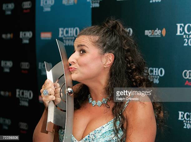 Opera singer Cecilia Bartoli kisses the trophy of the Echo Klassik Award 2006 on October 22 2006 in Munich Germany Bartoli received the music prize...