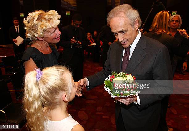 Opera singer Jose Carreras founder of the Jose Carreras Leukaemia foundation takes flowers as gift from a little girl after the announcement ceremony...