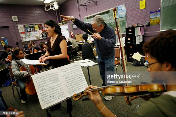 Opera singer, Karen Vuong, performs while Vance Miller, music director of Hamilton High School, directs his student orchestra including Jeffery J...