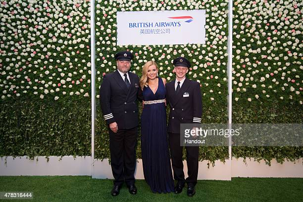 Opera Singer Katherine Jenkins poses with British Airways pilots during a British Airways Summer Themed Garden Party to mark the tenth anniversary of...