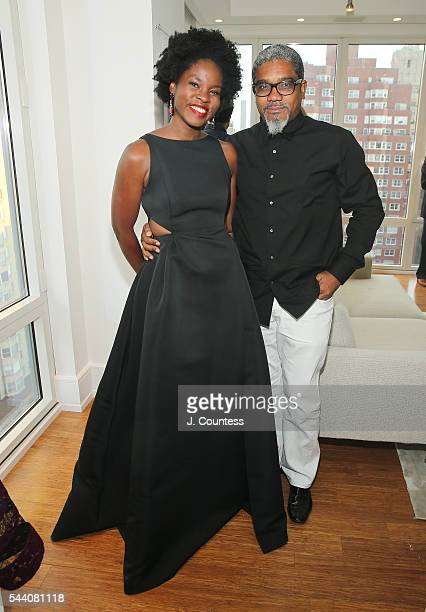 Opera singer Kristin Young and photographer Marc Baptiste pose for a photo at the 'Other Color' By Marc Baptiste Opening at the apART Private Gallery...