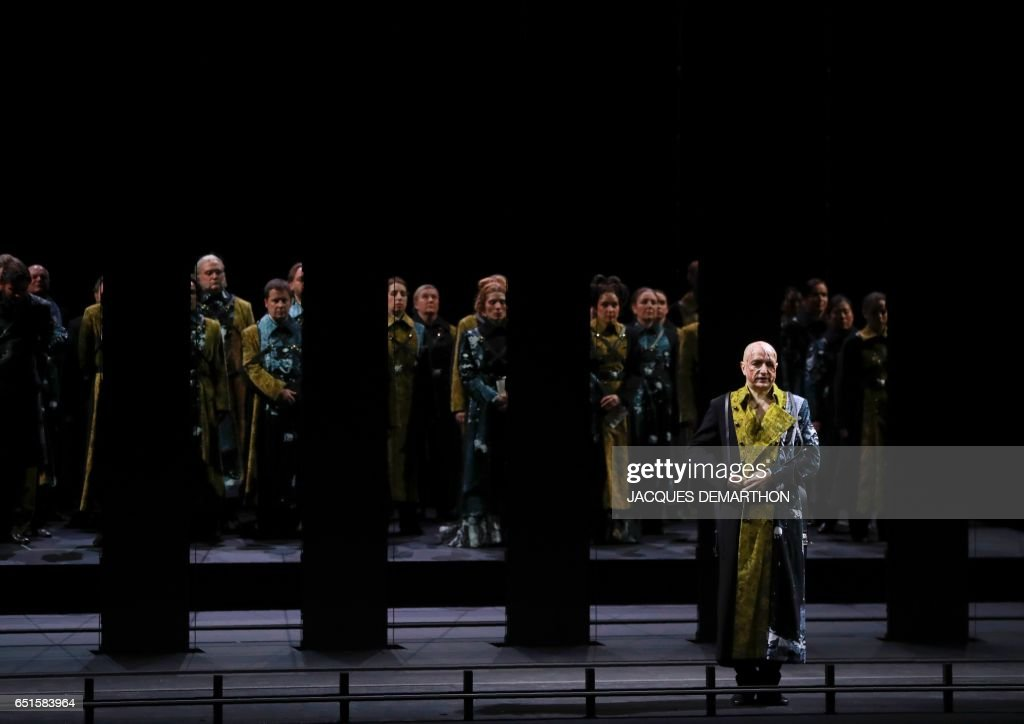 Opera singer Laurent Naouri performs during the rehearsal of 'Trompe la mort' at the Paris opera on March 10, 2017. / AFP PHOTO / Jacques DEMARTHON