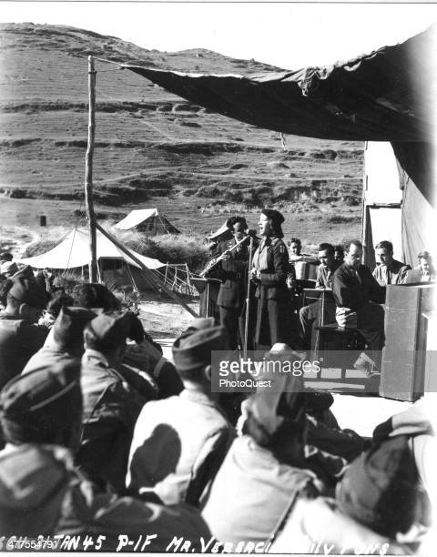 Opera singer Lily Pons and Frank Versaci perform during a USO show at 21st Field Hospital, Paoshan, China, January 21, 1944. The show was part of a...