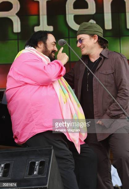 Opera Singer Luciano Pavarotti and Singer Bono of band U2 stand onstage during a sound check session for the Pavarotti and Friends 2003 concert May...