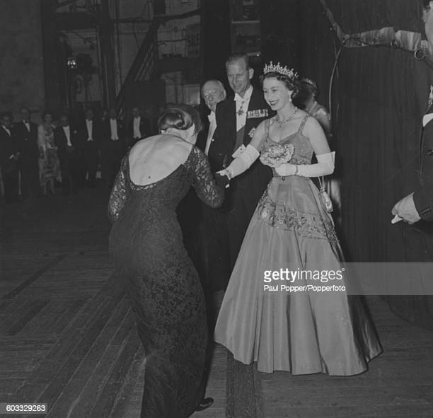Opera singer Maria Callas curtseys as she meets Queen Elizabeth II and Prince Philip Duke of Edinburgh following her appearance at a gala performance...
