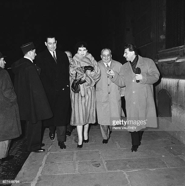 Opera singer Maria Callas walks down a Paris sidewalk with her husband Italian industrialist Giovanni Battista Meneghini and friends