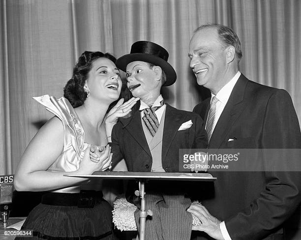 Opera singer Mimi Benzell Charlie McCarthy and ventriloquist Edgar Bergen Mimi sings Someday My Prince Will Come from Snow White on CBS Radios Edgar...