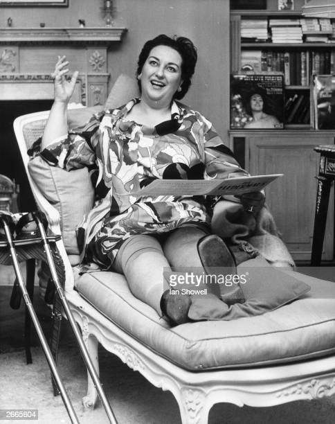 Opera singer Montserrat Caballe relaxes on a settee with her injured leg still bandaged after she broke it in a fall. She is in London to sing the...