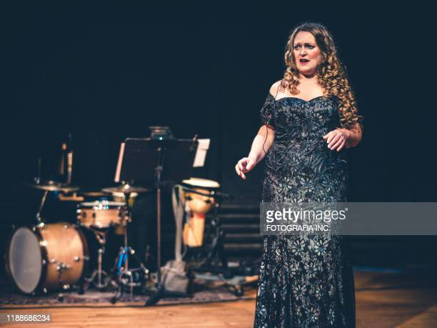 opera singer performing on the stage - hamilton musical stock pictures, royalty-free photos & images